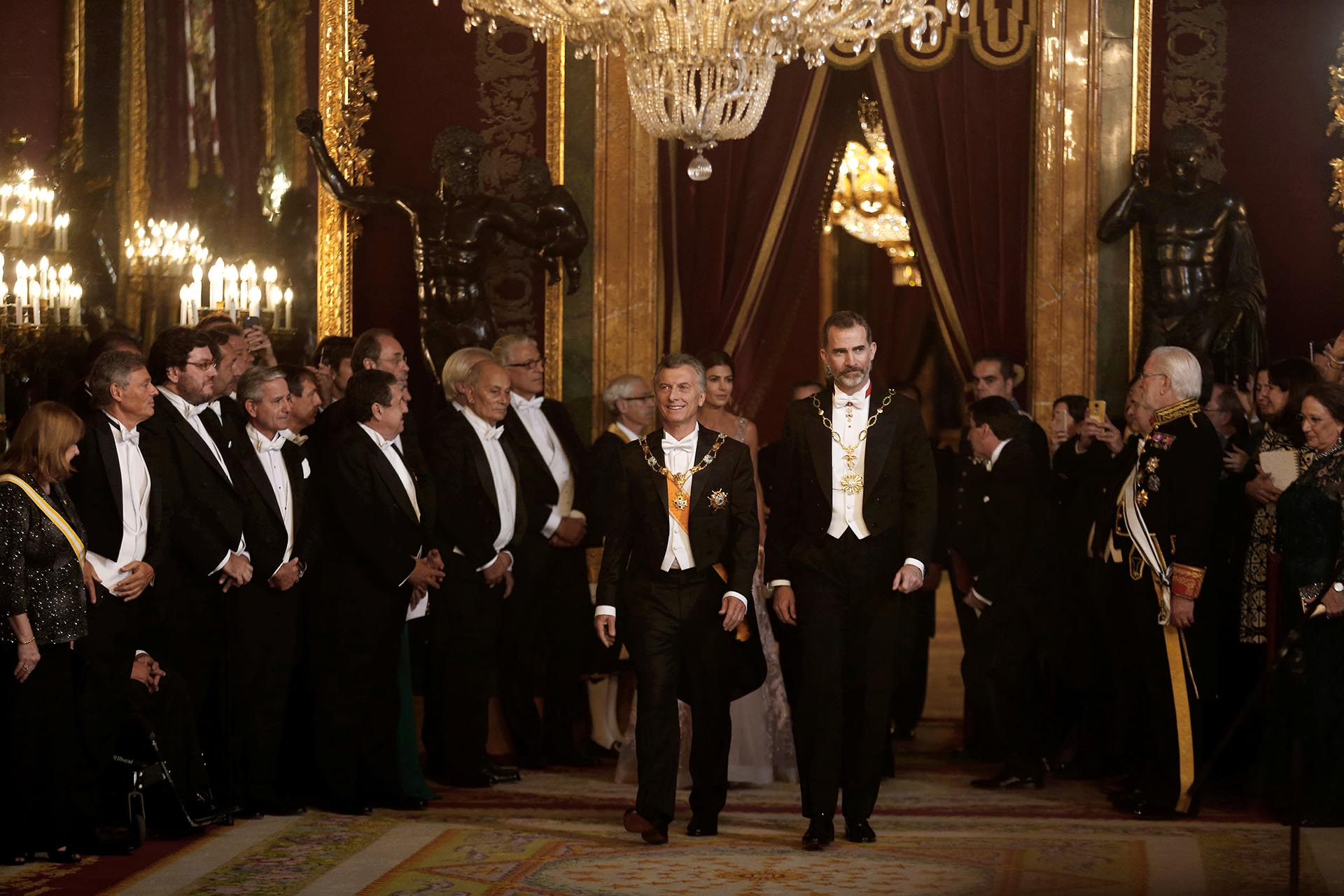 Argentina's Macri and Spain's King Felipe walk through guests during the gala dinner at Royal Palace inMadrid